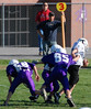 Jeremy Cassiday, no. 85, joins in the tackle on Papillion's runner.