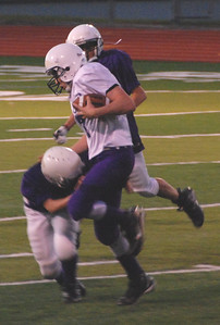 Lewis & Clark tries to stop Mission's Spencer Lewis no. 7.