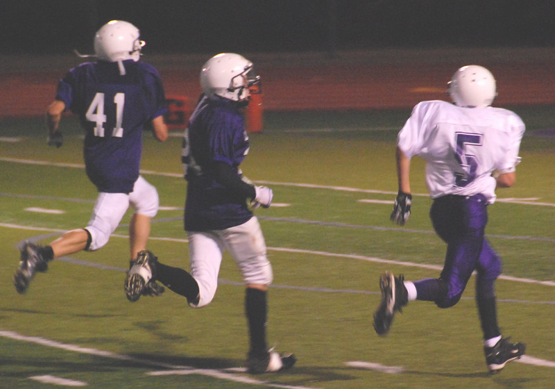 No. 41 Joel Wallace takes off for the end zone as Mission's Joe McKernan no. 5 tries to catch him.