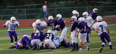 Underneath the pile, Mission recovers the fumble.