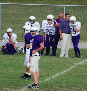 Jeremy consults with the coach and gets ready to take in the next play.