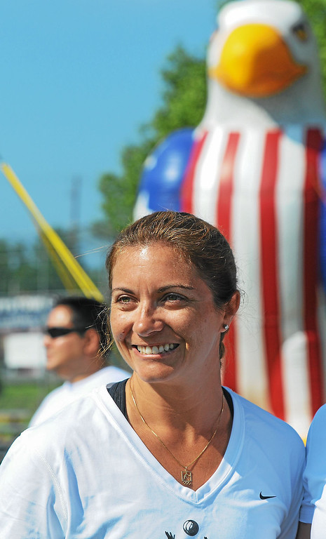 . Olympic gold medalist Misty May-Treanor looks out over the large crowd on hand for her volleyball clinic held at Pottstown\'s Memorial Park, Thursday, June 20, 2013. The clinics and May-Treanor\'s visits are part of the Volleyball Rumble, held annually in Pottstown. (Photo by John Strickler/The Mercury)