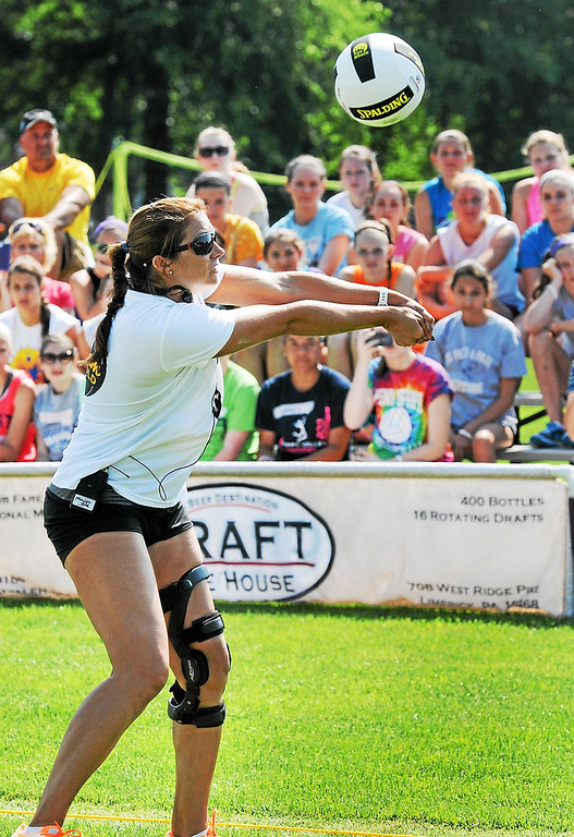 . Olympic gold medalist Misty May-Treanor passes a ball during a volleyball clinic demonstration at Memorial Park in Pottstown Thursday morning.  (Photo by John Strickler/The Mercury)