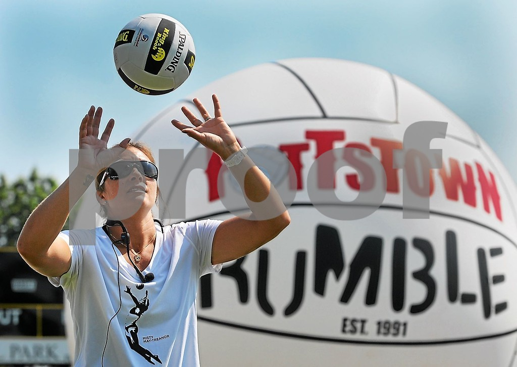 . Olympic gold medalist Misty May-Treanor shows the the large crowd demonstrates what skills she was looking for during her volleyball clinic held at Pottstown\'s Memorial Park Thursday morning, June 20, 2013. (Photo by John Strickler/The Mercury)