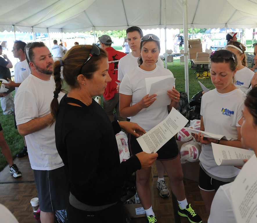 . Misty May-Treanor talks with volunteer coaches at the Dream in Gold Clinic. (Photo by John Strickler/The Mercury)