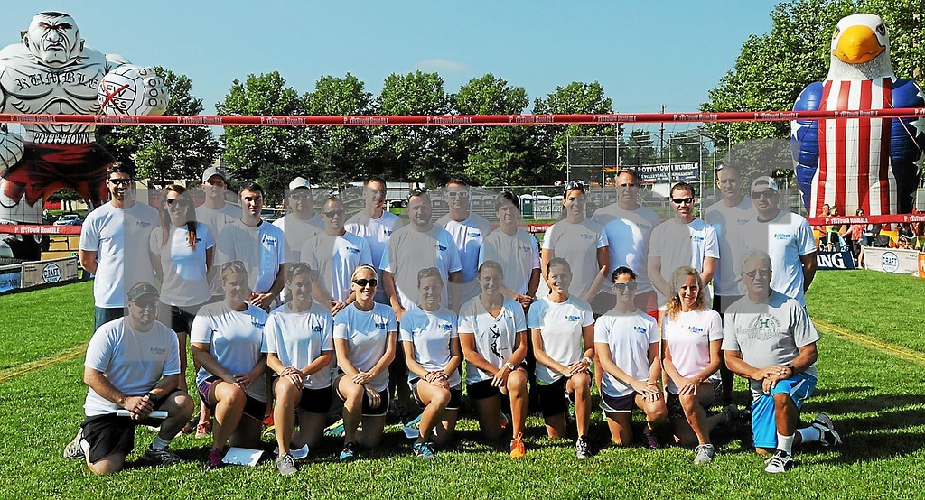 . Misty May-Treanor gets together with Pottstown Rumble youth training volunteers Thursday on center court in Memorial Park. (Photo by John Strickler/The Mercury)