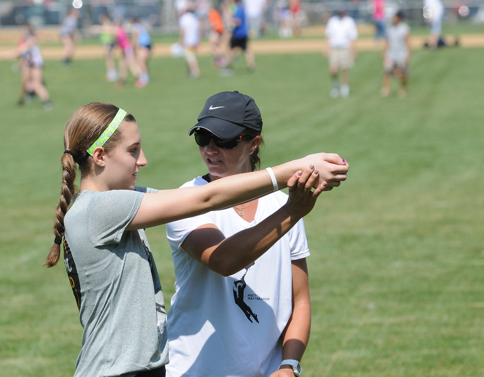 . Misty May-Treanor shows a Dream in Gold Clinic participant correct arm movements. (Photo by John Strickler/The Mercury)