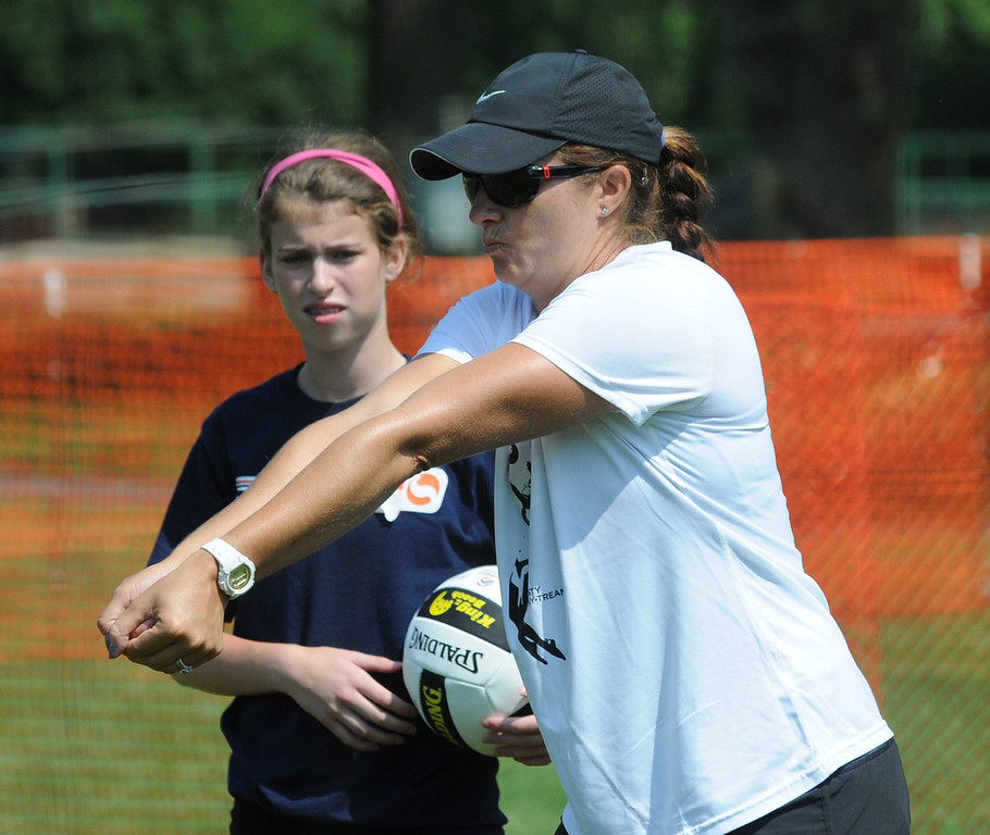 . Olympic volleyball champion Misty May-Treanor shows Dream in Gold Clinic participants the correct arm position. (Photo by John Strickler/The Mercury)