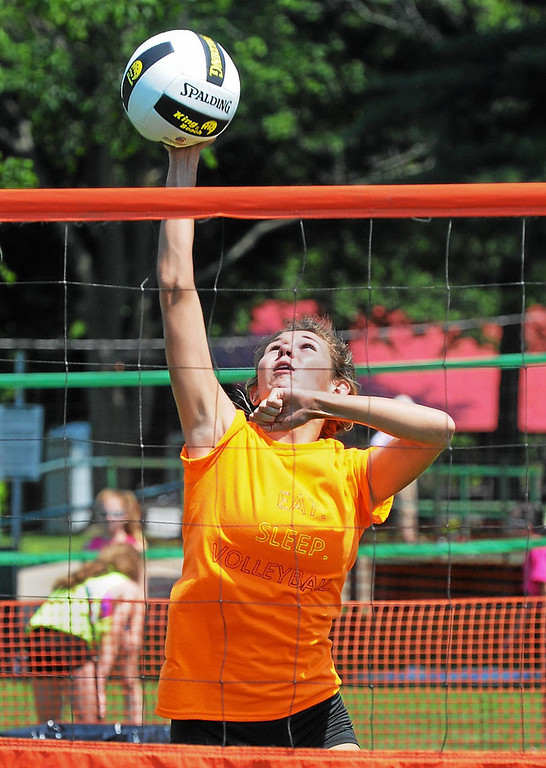 . Noel Steele spikes a  ball for a point in youth tournament competition at the Pottstown Rumble Friday. Photo by John Strickler/The Mercury