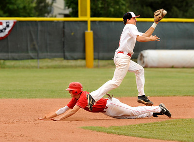Monarch-Brighton infielder Brandon Vaughn jumps over a Regis baserunner to stop a wild throw from catcher Connor Dunn during their game against Regis at Centaurus High School on Saturday, July 10, during the 4th Annual Boulder National Invitational Tournament. Regis defeated the Modogs 9-3. Photo by Jeremy Papasso /The Camera For more photos go to www.dailycamer.com