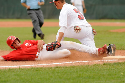Monarch-Brighton infielder Zac Wittmus tags out a Regis baserunner at third base during their game against Regis at Centaurus High School on Saturday, July 10, during the 4th Annual Boulder National Invitational Tournament. Regis defeated the Modogs 9-3. Photo by Jeremy Papasso /The Camera  For more photos go to www.dailycamer.com