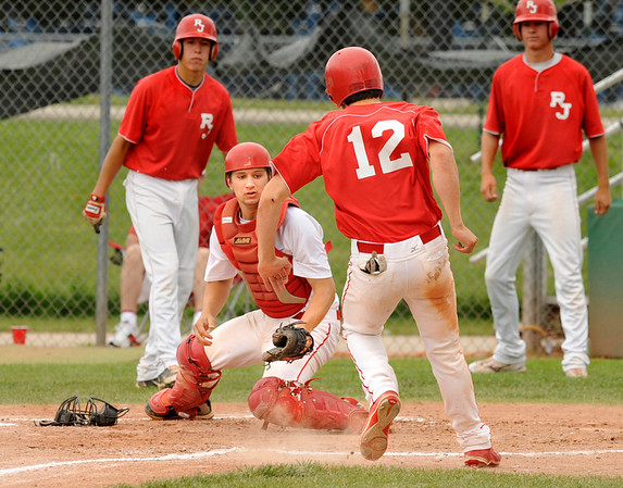 "Monarch-Brighton catcher Connor Dunn, at left, tags out a Regis baserunner during their game against Regis at Centaurus High School on Saturday, July 10, during the 4th Annual Boulder National Invitational Tournament. Regis defeated the Modogs 9-3.<br /> Photo by Jeremy Papasso /The Camera<br /> For more photos go to  <a href=""http://www.dailycamer.com"">http://www.dailycamer.com</a>"
