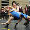 "Troy Naudin, top, of Monarch, tries to control  Mason Harms of Cherry Creek.<br /> For more photos of the match, go to  <a href=""http://www.dailycamera.com"">http://www.dailycamera.com</a>.<br /> January 14, 2012 / Cliff Grassmick"