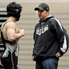 "Monarch wrestling coach, Ezra Paddock, right, talks one of his team members.<br /> For more photos of the match, go to  <a href=""http://www.dailycamera.com"">http://www.dailycamera.com</a>.<br /> January 14, 2012 / Cliff Grassmick"
