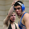 "Joe Tucker, left, of Monarch, beat Landon Lopez of Cherry Creek 14-5.<br /> For more photos of the match, go to  <a href=""http://www.dailycamera.com"">http://www.dailycamera.com</a>.<br /> January 14, 2012 / Cliff Grassmick"