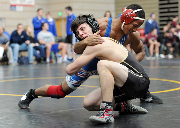 "Justin Butler, left, of Monarch, wins a decision over DeeCelreyell Shabazz (cq) of Cherry Creek.<br /> For more photos of the match, go to  <a href=""http://www.dailycamera.com"">http://www.dailycamera.com</a>.<br /> January 14, 2012 / Cliff Grassmick"