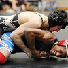 "Justin Butler, top, of Monarch, wins a decision over DeeCelreyell Shabazz (cq) of Cherry Creek.<br /> For more photos of the match, go to  <a href=""http://www.dailycamera.com"">http://www.dailycamera.com</a>.<br /> January 14, 2012 / Cliff Grassmick"