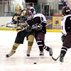 "Mountain Range High School's Joey Buchan passes the puck as Cheyenne Mountain's Tanner Taylor, No. 8, goes for a steal during a hockey game against Cheyenne Mountain High School on Wednesday, Dec. 14, at Boulder Valley Ice at Superior in Superior. Monarch won the game 7-1. For more photos of the game go to  <a href=""http://www.dailycamera.com"">http://www.dailycamera.com</a><br /> Jeremy Papasso/ Camera"