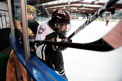 Fairview High School's Noah Zimmerman, left, gets checked into the wall by Cheyenne Mountain's Jerry Lacayo during a hockey game against Cheyenne Mountain High School on Wednesday, Dec. 14, at Boulder Valley Ice at Superior in Superior. Monarch won the game 7-1. For more photos of the game go to www.dailycamera.com Jeremy Papasso/ Camera