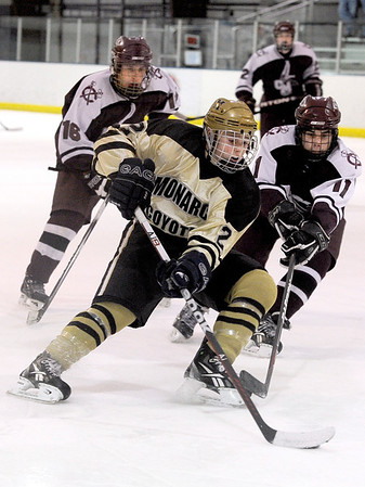 """Fairview High School's Noah Zimmerman moves the puck past Cheyenne Mountain's Marcus Martin-wegryn during a hockey game against Cheyenne Mountain High School on Wednesday, Dec. 14, at Boulder Valley Ice at Superior in Superior. Monarch won the game 7-1. For more photos of the game go to  <a href=""""http://www.dailycamera.com"""">http://www.dailycamera.com</a><br /> Jeremy Papasso/ Camera"""