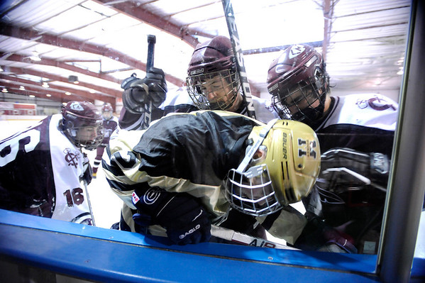 "Fairview High School's Noah Zimmerman, center, gets checked into the wall by a swarm of Cheyenne Mountain players during a hockey game against Cheyenne Mountain High School on Wednesday, Dec. 14, at Boulder Valley Ice at Superior in Superior. Monarch won the game 7-1. For more photos of the game go to  <a href=""http://www.dailycamera.com"">http://www.dailycamera.com</a><br /> Jeremy Papasso/ Camera"