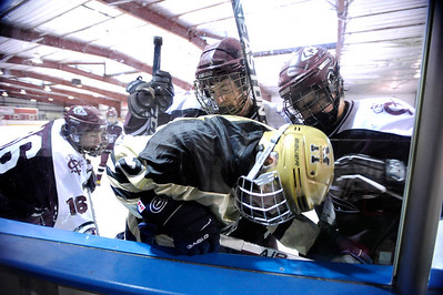 Fairview High School's Noah Zimmerman, center, gets checked into the wall by a swarm of Cheyenne Mountain players during a hockey game against Cheyenne Mountain High School on Wednesday, Dec. 14, at Boulder Valley Ice at Superior in Superior. Monarch won the game 7-1. For more photos of the game go to www.dailycamera.com Jeremy Papasso/ Camera