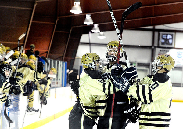 "Centaurus High School's David Neitenbach, center, is congratulated by his teammates after scoring a goal during a hockey game against Cheyenne Mountain High School on Wednesday, Dec. 14, at Boulder Valley Ice at Superior in Superior. Monarch won the game 7-1. For more photos of the game go to  <a href=""http://www.dailycamera.com"">http://www.dailycamera.com</a><br /> Jeremy Papasso/ Camera"