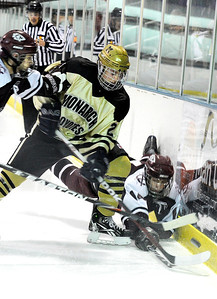 Fairview High School's Noah Zimmerman, center, steals the puck from Cheyenne Mountain's Brockton Ward, right, after checking him into the wall during a hockey game against Cheyenne Mountain High School on Wednesday, Dec. 14, at Boulder Valley Ice at Superior in Superior. Monarch won the game 7-1. For more photos of the game go to www.dailycamera.com Jeremy Papasso/ Camera