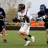 Monarch's Dillon Vendetti (center) looks to pass as Alexander Dawson's Scott Rutherford (left) and Chance Creger defend during the game at Monarch High School in Louisville, Thursday, April 29, 2010.<br /> Kasia Broussalian/The Camera