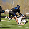 Monarch's Dillon Vendetti falls to the ground after being hit by Alexander Dawson's Chance Creger during the game at Monarch High School in Louisville, Thursday, April 29, 2010.<br /> Kasia Broussalian/The Camera