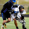 Monarch's Nathan Puldy (right) and Alexander Dawson's Stevie Nash fight for the face off during the game at Monarch High School in Louisville, Thursday, April 29, 2010.<br /> Kasia Broussalian/The Camera