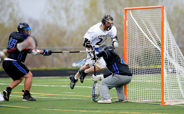 Monarch's Dylan Rigter goes for a shot against Alexander Dawson's goalie for a goal during the game at Monarch High School in Louisville, Thursday, April 29, 2010.<br /> Kasia Broussalian/The Camera