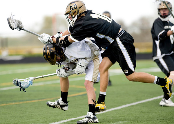 Monarch's Mike Roberts is hit by Rock Canyon's Parker Jackson during the game at Monarch High School in Louisville, Friday, May 7, 2010. <br /> <br /> Kasia Broussalian