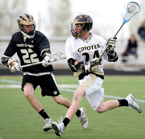 Monarch's Dylan Ritger (right) runs the ball down field as Rock Canyon's Conor Regan defends during the game at Monarch High School in Louisville, Friday, May 7, 2010. <br /> <br /> Kasia Broussalian