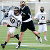 Monarch's Nathan Puldy (left) is hit by Rock Canyon's Trey Buckland during the game at Monarch High School in Louisville, Friday, May 7, 2010. <br /> <br /> Kasia Broussalian