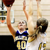 Fort Collins High School sophomore Ashley Evans takes a shot over Monarch's Ashton Davis on Friday, Jan. 21, during a basketball game against Monarch High School at Monarch High School. Fort Collins lost the game 66-44.<br />  Jeremy Papasso/ Camera