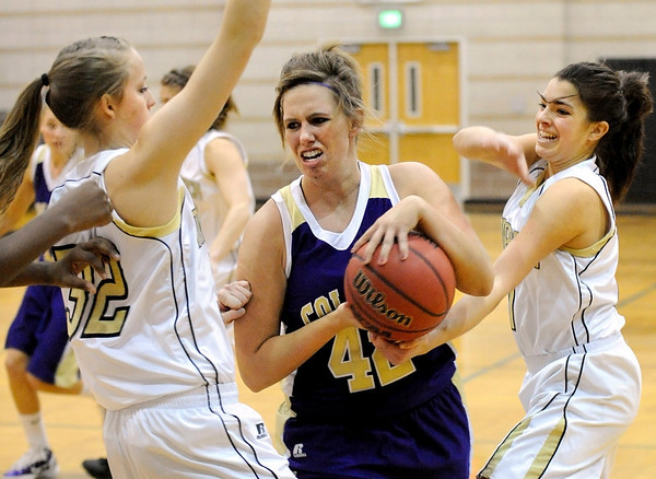 Fort Collins High School senior Danyelle Minchow fights to keep her rebound on Friday, Jan. 21, during a basketball game against Monarch High School at Monarch High School. Fort Collins lost the game 66-44.<br />  Jeremy Papasso/ Camera
