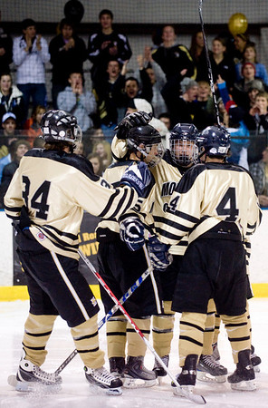 Monarch players congratulate each other after scoring against Peak to Peak during their game at Boulder Valley Ice in Superior, Friday, Jan. 8, 2009. <br /> KASIA BROUSSALIAN