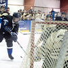 Peak to Peak's Alex Andony (8) shoots towards Monarch's goalie, Zane Sampson (33) during their game at Boulder Valley Ice in Superior, Friday, Jan. 8, 2009. <br /> KASIA BROUSSALIAN