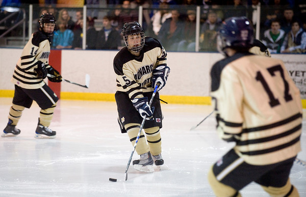 Monarch's Geoff Howell (center) looks for an opening to pass while playing Peak to Peak during their game at Boulder Valley Ice in Superior, Friday, Jan. 8, 2009. <br /> KASIA BROUSSALIAN