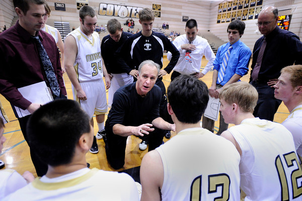 "Monarch High School Head Coach Ken Niven makes a game plan with his team while in a time-out during a game against Air Academy High School on Friday, Dec. 16, at Monarch High School. For more photos of the game go to  <a href=""http://www.dailycamera.com"">http://www.dailycamera.com</a><br /> Jeremy Papasso/ Camera"