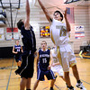 "Monarch High School's Nathan Brooks takes a shot over Mike Fertig during a game against Air Academy High School on Friday, Dec. 16, at Monarch High School. For more photos of the game go to  <a href=""http://www.dailycamera.com"">http://www.dailycamera.com</a><br /> Jeremy Papasso/ Camera"