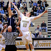 "Monarch High School's Wes Moon wins the tip off against Jeremy Reitinger during a game against Air Academy High School on Friday, Dec. 16, at Monarch High School. For more photos of the game go to  <a href=""http://www.dailycamera.com"">http://www.dailycamera.com</a><br /> Jeremy Papasso/ Camera"
