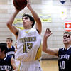 "Monarch High School's Nathan Brooks takes a shot during a game against Air Academy High School on Friday, Dec. 16, at Monarch High School. Monarch lost the game 55-51. For more photos of the game go to  <a href=""http://www.dailycamera.com"">http://www.dailycamera.com</a><br /> Jeremy Papasso/ Camera"
