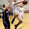 "Monarch High School's Hank Yen drives to the hoop past Air Academy's Austin McCarthy during a game against Air Academy High School on Friday, Dec. 16, at Monarch High School. Monarch lost the game 55-51. For more photos of the game go to  <a href=""http://www.dailycamera.com"">http://www.dailycamera.com</a><br /> Jeremy Papasso/ Camera"