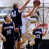 """Monarch High School's Dan Sorenson drives to the hoop past Air Academy's Jeremy Reitinger during a game against Air Academy High School on Friday, Dec. 16, at Monarch High School. Monarch lost the game 55-51. For more photos of the game go to  <a href=""""http://www.dailycamera.com"""">http://www.dailycamera.com</a><br /> Jeremy Papasso/ Camera"""