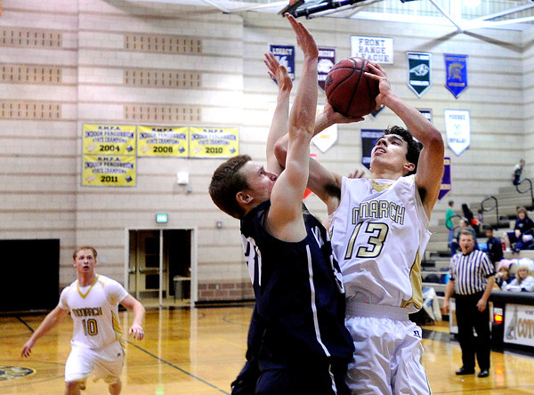 "Monarch High School's Nathan Brooks takes a shot over Air Academy's Geno Bigelow during a game against Air Academy High School on Friday, Dec. 16, at Monarch High School. Monarch lost the game 55-51. For more photos of the game go to  <a href=""http://www.dailycamera.com"">http://www.dailycamera.com</a><br /> Jeremy Papasso/ Camera"