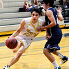 "Monarch High School's Nathan Brooks drives past a defender during a game against Air Academy High School on Friday, Dec. 16, at Monarch High School. Monarch lost the game 55-51. For more photos of the game go to  <a href=""http://www.dailycamera.com"">http://www.dailycamera.com</a><br /> Jeremy Papasso/ Camera"