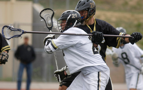 """Monarch's Gus Sawicki, #28, chases down Arapahoe's Adam Jones, #10, on Saturday May, 12, 2012. Aurora Colo.<br /> Photo by Derek Broussard<br /> For more photos visit  <a href=""""http://www.dailycamera.com"""">http://www.dailycamera.com</a>"""