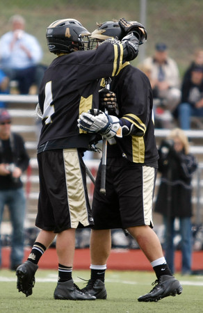 """Monarch's Connor Eakes,#13, congratulates Kyle Donner, #4, after scoreing the only point  for Monarch on Saturday May, 12, 2012. Aurora Colo.<br /> Photo by Derek Broussard<br /> For more photos visit  <a href=""""http://www.dailycamera.com"""">http://www.dailycamera.com</a>"""